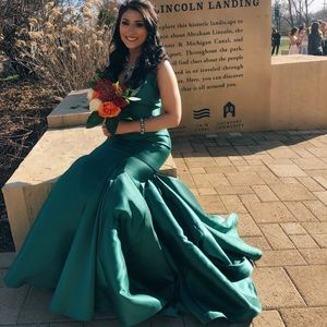 emerald green mermaid style dress with a train